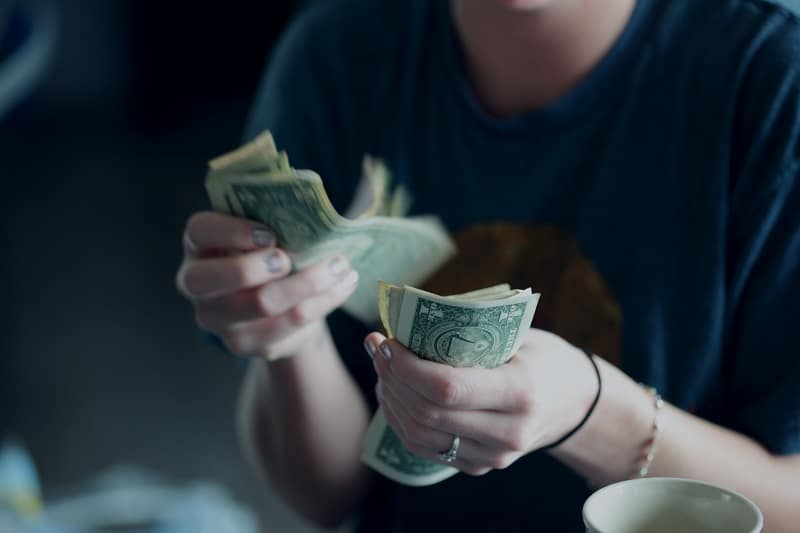 woman counting cash in her hands